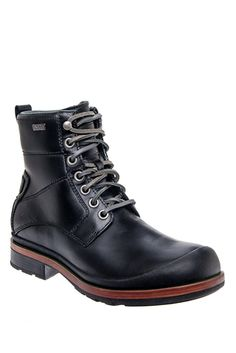 Men's Howell Casual Flat Waterproof Boot - Black at DNA FOOTWEAR | Equal parts hip and handsome, the Howell is an urban workboot with the heritage feel of UGG®. Waterproof full-grain leather, breathable eVent® bootie, and rubber lug outsole lend rugged luxury to a wear-anywhere lace-up. #DNAHOLIDAY