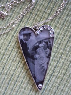 "Custom made resin filled pendant from my ""Family Tree Jewelry"" line...beautifully vintage look to this heart shaped pendant...great way to keep those old black and white's in style!"