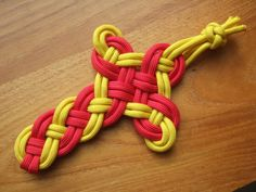 Celtic Cross with Paracord. Link for tutorial is here..http://www.free-macrame-patterns.com/celtic-cross.html
