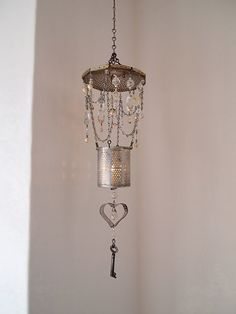 love these chandeliers.  could be wind chimes with recycled chimes or old spoons.  Add bitty baubles, ribbons, cookie cutters, old keys.  Would be a cool party craft!