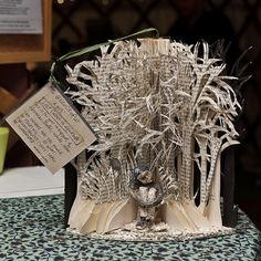 This beautiful, intricate book sculpture and six others have been anonymously created and deposited around Edinburgh, Scotland over the last few months.  Aren't they incredible? Click through for the full story and more pics.