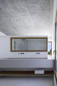 Minimal bathroom interior with concrete sink.