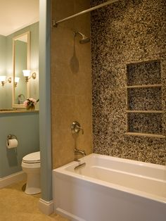 I like the pebble tile on one wall.  Arts and Crafts Bathrooms from Laura A. Suglia-Isgro : Designers' Portfolio 4146 : Home & Garden Television
