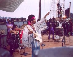 Jimi Hendrix sends a message of love at the Woodstock Music and Arts Festival.