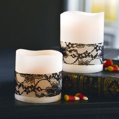 Easy DIY Halloween decor idea - simply wrap LED candles with black lace ribbon.