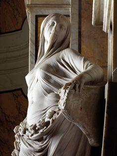 Sculptor unknown: title unknown [female figure veiled], stone sculpture.