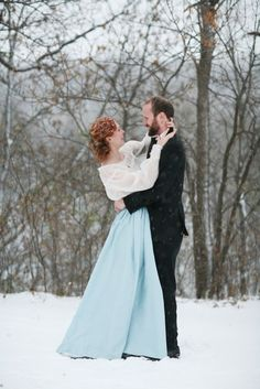Ellen and Colin's Minnesota Wedding, with a handmade canoe, a homemade wedding dress and lots of snow.