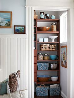 for a pretty pantry, use baskets and bins in the same color palette as seen in the kitchen