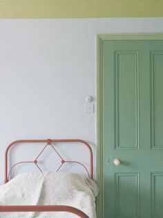 Playful Farrow & Ball shades straight out of a crayon box play in a sophisticated way against a white background. Calluna No. 270 (wall), Churlish Green No. 251 (ceiling), Folly Green No. 76 (door). | Photo: Courtesy of Farrow & Ball
