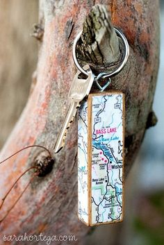Easy souvenir keychain using a Jenga block and roadmap clipping from your vacation.