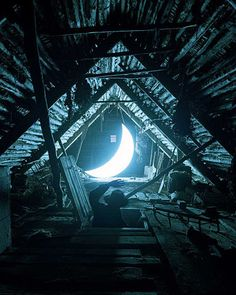 He opened the hatch, not to what he expected. There lay the crescent moon, in full regalia. Blinding light, an adventure called. The crescent moon had lost it's way, the oval moon above was dark in misery...