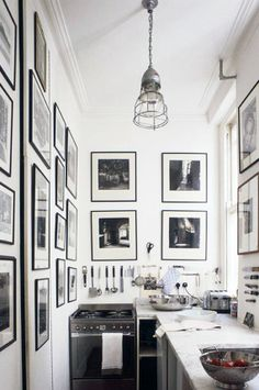A black and white galley kitchen.