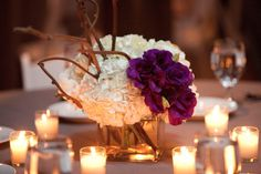Kate Parker Designs at Rivermill at Dover Ladning hydrangea centerpieces with craspedia, purple lisanthus, and kiwi vine.