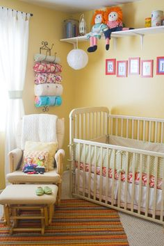 Cute way to store baby blankets so you can see them in a nursery - I've seen this for towels, but love it for pretty blankets. I like the shelf too.