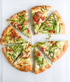 Shaved asparagus and whipped ricotta take homemade pizza to the next level.