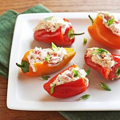 These low-cal Creamy Stuffed Peppers will fly off the buffet table! More easy party snacks:  http://www.bhg.com/recipes/party/appetizers/easy-snacks/?socsrc=bhgpin091613stuffedpeppers#page=10