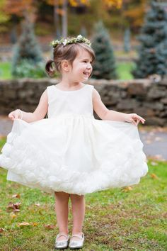 This flower girl is very happy to be wearing her pretty dress: http://www.stylemepretty.com/little-black-book-blog/2014/02/11/rustic-fall-woodstock-inn-wedding/ | Photography: AMW Studio - http://amwstudios.com/
