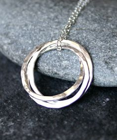 Pretty necklace for birthmom. Three interlocking circles signifying adoption triad - meaningful but discrete.