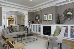 grey living room - paint color Sherwin Williams' Prairie Grass SW 7546 or Koi Pond SW 7727 (for more green tone) is similar to this green wall. @Brenda Bartel this is perfect! it has that olive green and the gray i like!