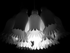 A beautiful handmade lamp reusing materials. I want this for my home!  Garden lamp by Alejandra Vargas Díaz, via Behance