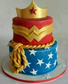 super hero cake - WONDER WOMAN!!!!!!!! (I like the bottom tier for this one!)... good since I need to combine boy/girl theme!!!!