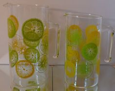 Large and small orange and lemon slice #Pyrex pitchers