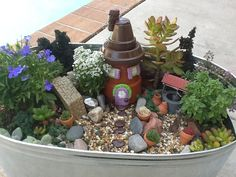Fairy garden idea. Made the house with small painted terra cotta pots and polymer clay