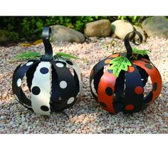 Pumpkins with Polka Dots - Set of 2 Material: Metal Size: 8.25 x 8.25 x 9.50 Whimsical pumpkins decorated with black/white; orange/black polka dots. Arriving Summer 2013