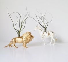 Assemble a metallic menagerie — and adorn the animals with air plants. #etsygifts