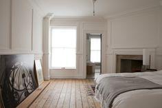William Smalley flat in Bloomsbury, wood floors, white paneled walls | Remodelista