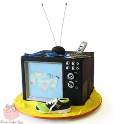"""Remember the days of indoor antennas and picture-tube TV sets? Televisions have come a long way and this birthday cake pays homage to the """"old fashion"""" television set."""