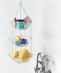 Check the kitchen section instead of the bathroom department for great funds for bathroom, organization/storage - like this hanging fruit basket.