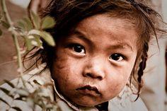 Photo by © Eric Montfort  Nepali child  http://www.flickr.com/photos/glouk/4184694432/