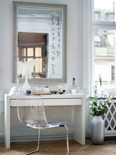 Gorgeous bedroom vanity composed of Ikea Songe Mirror over Ikea Malm Dressing Table paired with Ikea Tobias Chair. Make-up vanity filled with Ikea Salong Vase, Ikea Dimmig Vase and Ikea Skimmer Candlestick.