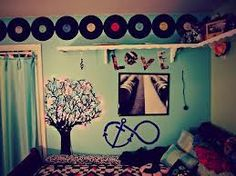 """-vinyls at the top -tree lights -magazine cut-out quote -""""i refuse to sink"""" symbol"""