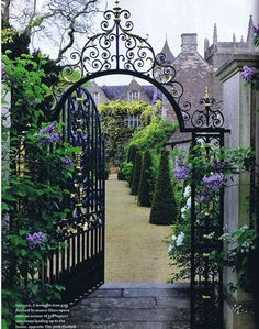 Beautiful gate leading to dreamy gardens at the historic house, Hanham Court, UK