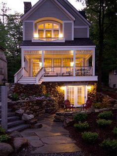 GORGEOUS. I love this as the back of a house. It would have to be somewhere kind of secluded with all those balconies. Porch, balcony, walk out basement, STONE. Gorgeous.