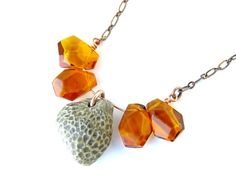 fossil coral and amber, love how they are both like honeycombs and they both aren't!  #jewelry #necklace #honey #bee #honeybee #coral #fossil #amber #etsy #orange #handmade