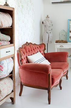 love this coral colored velvet sofa