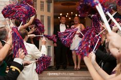 Ole Miss pom poms instead of rice/petals/sparklers