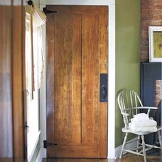 Six layers of paint was stripped off to refinish this heart-pine door separating the bathroom and bedroom. | Photo: Patricia Lyons
