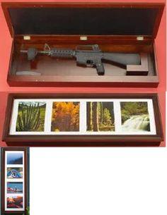 secret gun storage behind picture