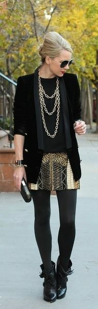 Love the sequin skirt and boots. Id put some long pearls with this instead of the awful chain...
