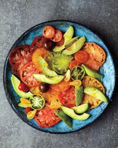 I just love heirloom tomatoes. 2 pounds assorted tomatoes (any color), sliced or halved if small  1 avocado, halved, pitted, peeled, and sliced  Extra-virgin olive oil  Coarse salt and ground pepper