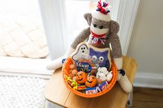 Fill a basket with delicious treats and #Halloween goodies for a sweet gift for your neighbors and friends.