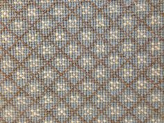 This is a woven wool carpet with a blue and brown diamond pattern. This is one of 13 new carpet shorts rolls we have recently added to our inventory. http://carpetworkroom.com