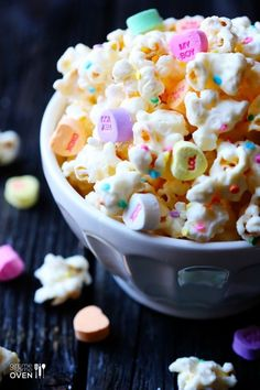 confetti sprinkle rainbow popcorn with valentine's day candy hearts