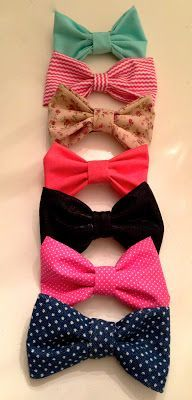 DIY Bows(: take a strand of fabric and glue it together so you end up having kinda like a loop, then you take a smaller piece and wrap it around the center of the loop so you end up with the bow shape.