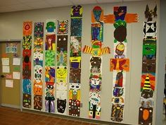 a project based on artwork of Native American people of the Pacific Northwest.  We learned about stylization.  Stylization is how an artist changes how something looks in order to make it look different than it does in real life.  Students looked specifically at totem poles.  Each student picked an animal to stylize and then paint.  The finished paintings were hung in stacks to simulate real totem poles.