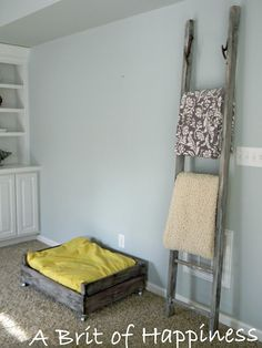 Vintage ladder to hang throws....perfect to hang my quilts
